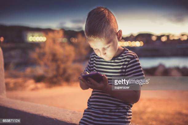 Brothers using cell phone