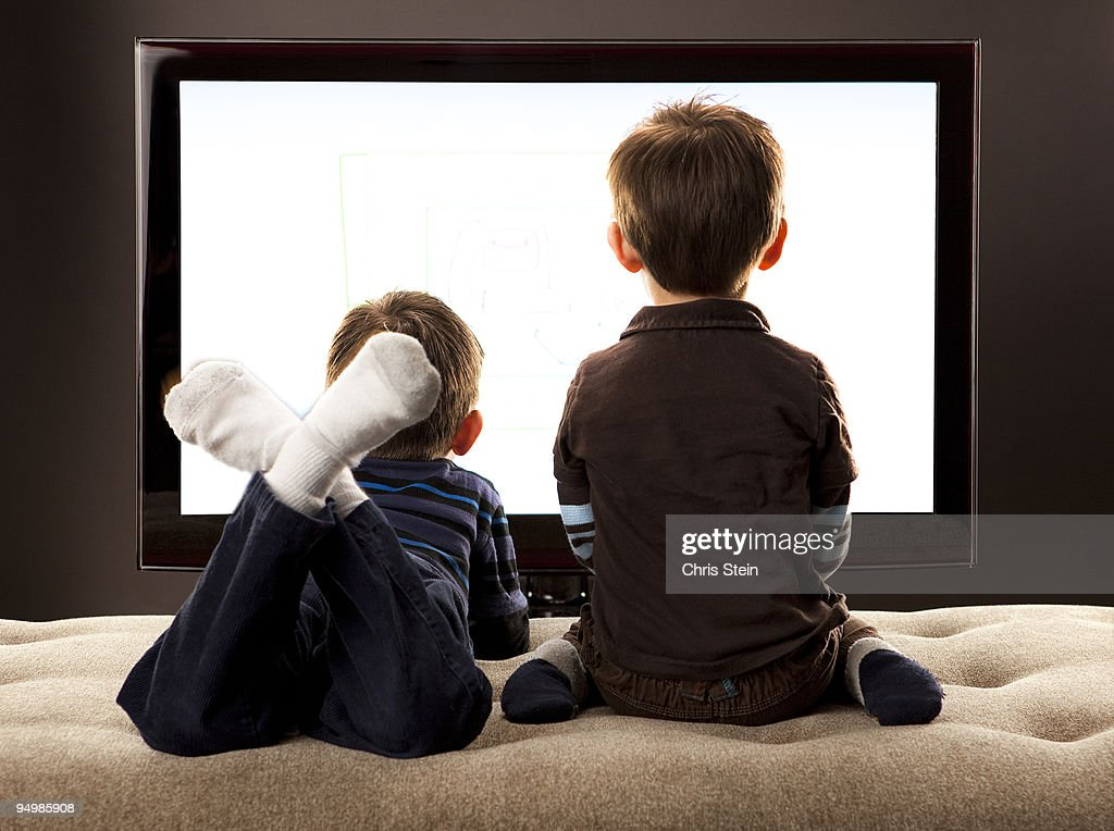 Brother's Watching TV : Stock Photo