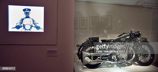 Brough Superior SS100 motorcycle belonging to T E Lawrence is seen next to a video screen in a new exhibition 'Lawrence of Arabia the life the...