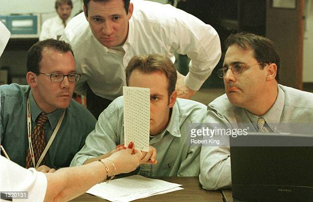 Broward County Election employees, reporters and Judicial Watch members look at undervotes December 18, 2000 at the Broward County Elections...