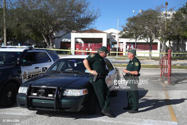 Broward County Sheriff officers Brad Griesinger and Jamie Rubenstein stand guard at the entrance to Marjory Stoneman Douglas High School on February...