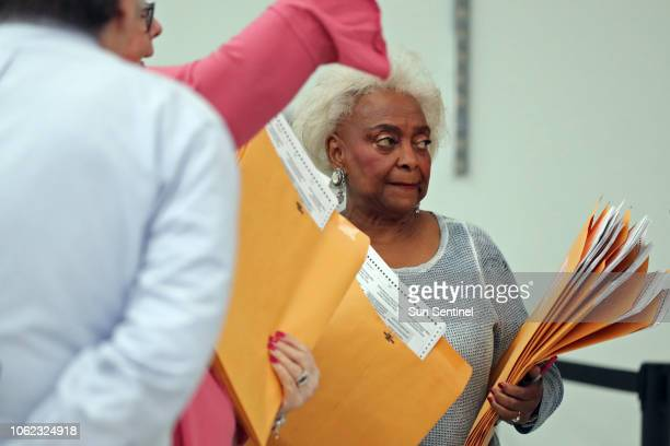 Broward County Supervisor of Elections Brenda Snipes holds the first ballots to be hand counted in the senate race ascounting begins at the Broward...