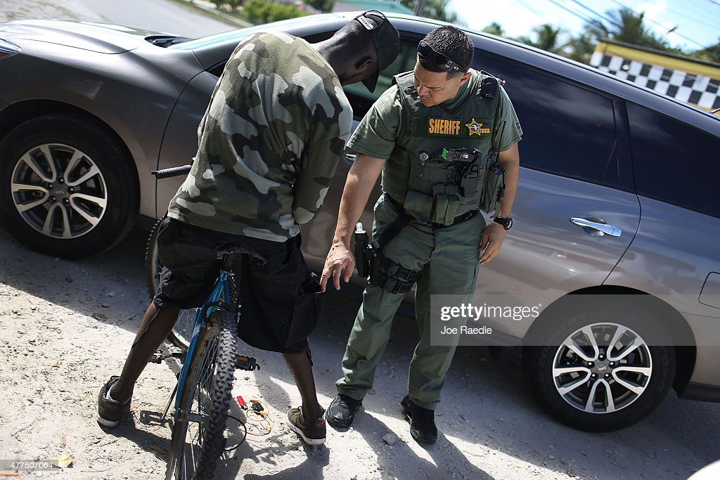 Broward Sheriff's Office Sergeant Ozzy Tianga stops a man ...