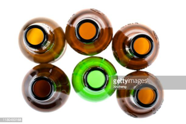 brown and green bottles seen from above - high section stock pictures, royalty-free photos & images