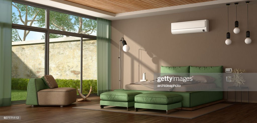 Brown and green modern master bedroom : Stock Photo