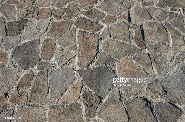 brown and grey cobblestone pathway - paving stone stock pictures, royalty-free photos & images