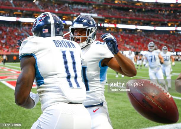Brown and Jonnu Smith of the Tennessee Titans celebrate after Brown scored a touchdown in the first half of an NFL game against the Atlanta Falcons...