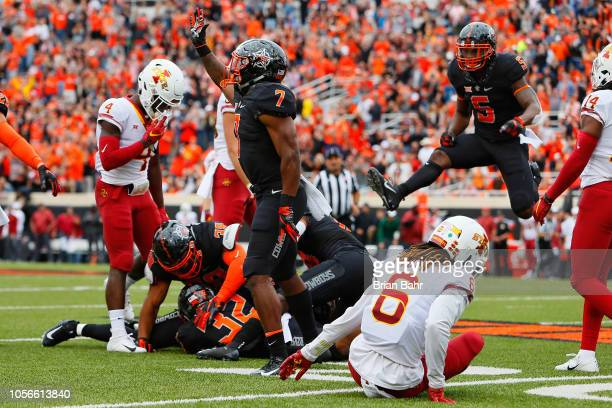 Brown and Justice Hill of the Oklahoma State Cowboys celebrate a fumble recovery by Amen Ogbongbemiga against defensive back De'Monte Ruth of the...