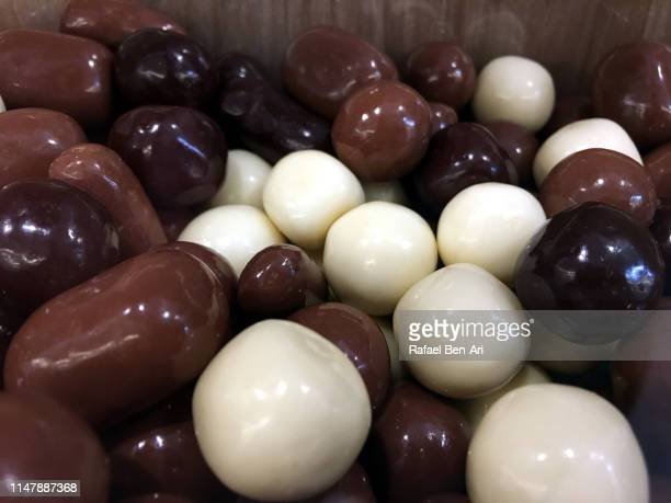 brown and white chocolate ball - rafael ben ari stock-fotos und bilder