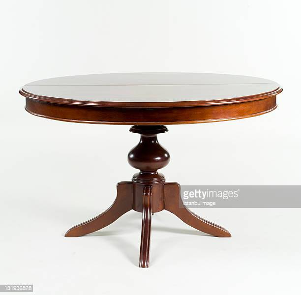 Brown antique table with round table top