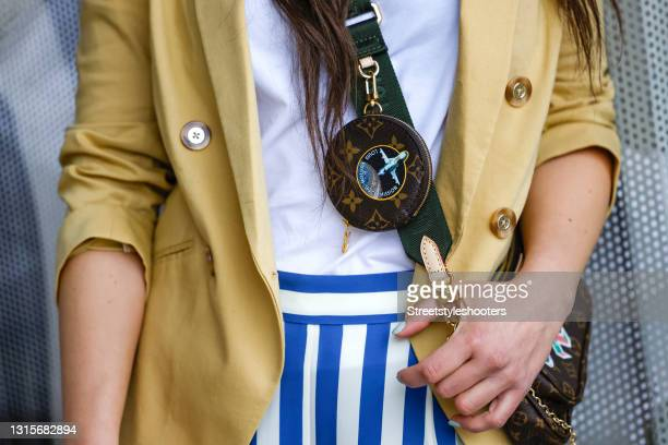 Brown bag by Louis Vuitton as a detail of German singer Jasmin Wagner during a street style shooting on May 1, 2021 in Hamburg, Germany.