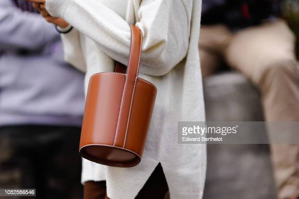 A brown bag is seen outside Issey Miyake during Paris Fashion Week Womenswear Spring/Summer 2019 on September 28 2018 in Paris France