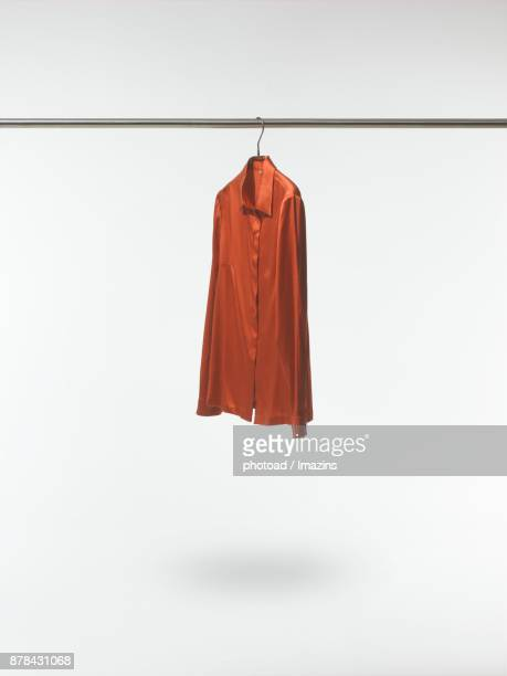 brown blouse on a hanger - blouse imagens e fotografias de stock