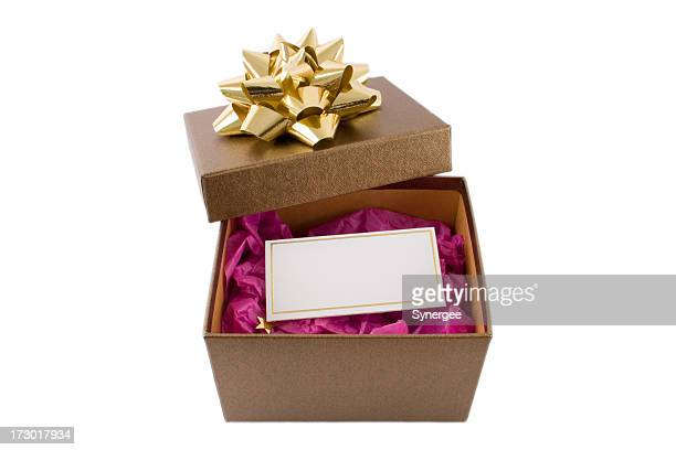 A brown box open with a blank card
