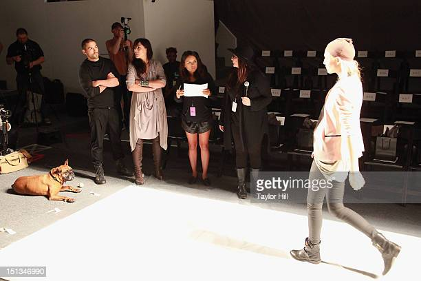 Brown boxer Jake Kunz designers Christopher and Nicholas Kunz a guest and publicist Kelly Cutrone of People's Revolution review models at the...