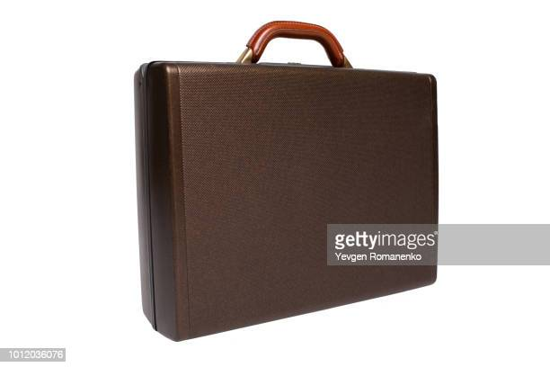 brown briefcase isolated on white background - briefcase stock photos and pictures