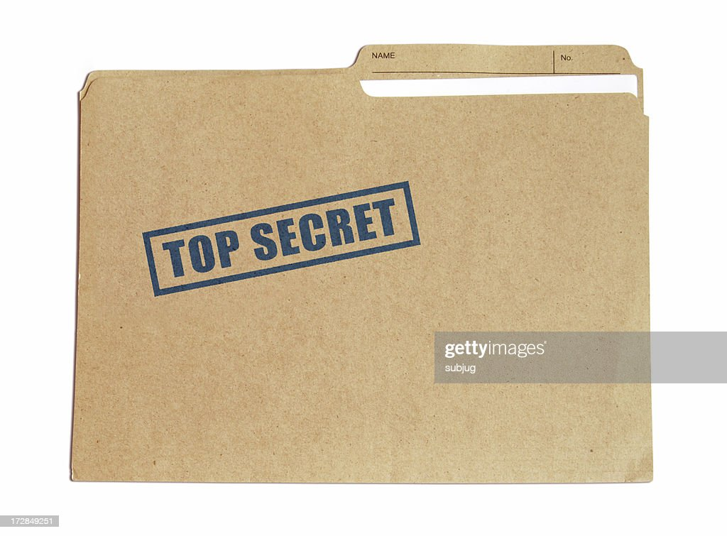 Brown card folder with top secret stamped on it in blue : Stock Photo