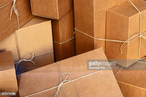 Brown cardboard boxes, tied with strings, full frame.