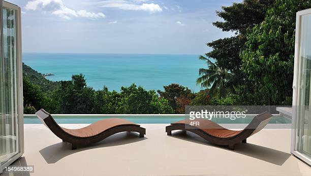 brown chaise lounges at private pool villa - stereotypically upper class stock pictures, royalty-free photos & images
