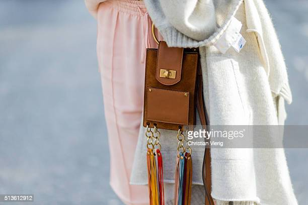 A brown Chloe mini bag with fringes outside Chloe during the Paris Fashion Week Womenswear Fall/Winter 2016/2017 on March 3 2016 in Paris France