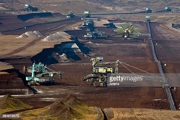 Brown coal / lignite being extracted by huge bucketwheel excavators at openpit mine SaxonyAnhalt Germany