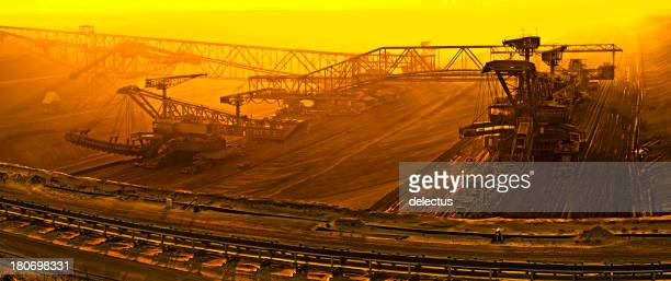 brown coal opencast mining at dusk - coal mining stock photos and pictures