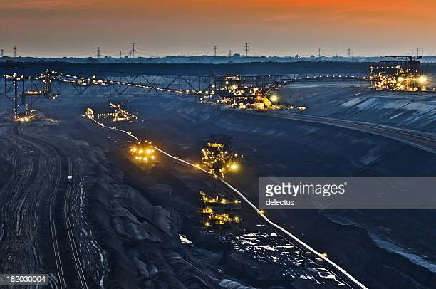 brown coal opencast mining at night - coal mining stock photos and pictures