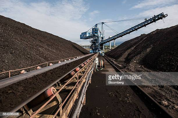 Brown coal sits on a conveyor belt as it is transported at the Visonta open cast lignite mine operated by Matrai Eromu Zrt in Visonta Hungary on...