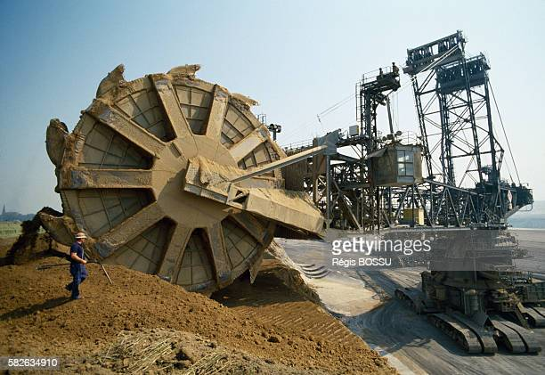 Brown coal strip mining Gigantic bucket wheel excavator moving earth to reach brown coal at a site near Cologne Nord Rhein Westphalen