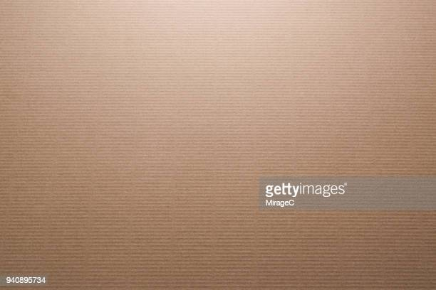 brown color corrugated cardboard - papier stock-fotos und bilder