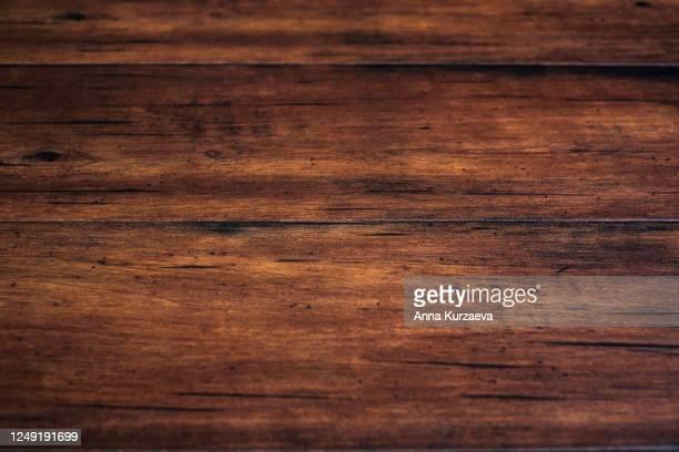 brown coloured wooden scratched background. natural background. - holz stock-fotos und bilder