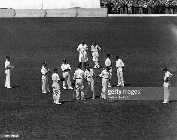 Brown congratulates Len Hutton on breaking Donald Bradman's record during the England versus Australia cricket match at the Oval in 1938. | Location:...