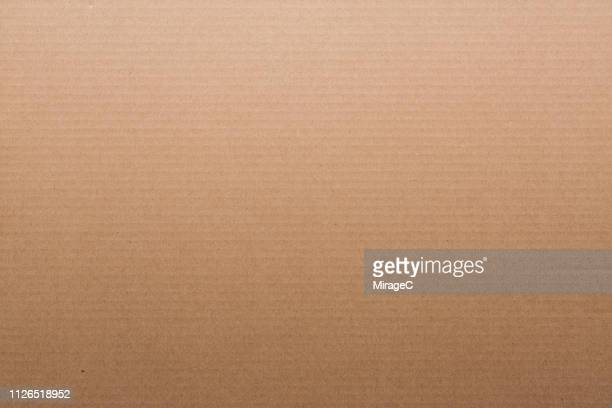 brown corrugated cardboard - carton stock photos and pictures