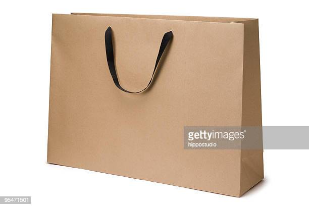 brown craft paper bag - shopping bag stock pictures, royalty-free photos & images