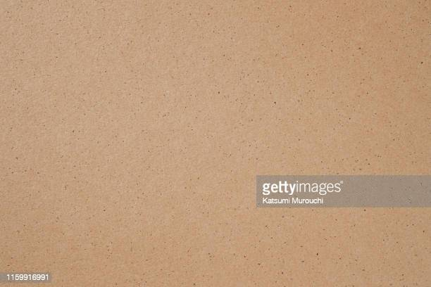 brown craft paper cardboard texture background - brown paper stock pictures, royalty-free photos & images