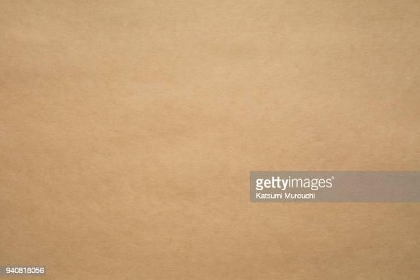 brown craft paper texture background - bruin stockfoto's en -beelden