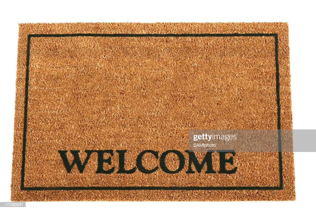 Brown doormat with Welcome and a rectangular frame : Stock Photo