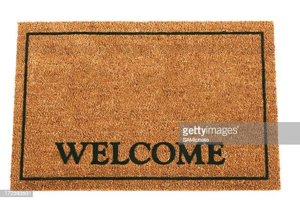 Brown doormat with Welcome and a rectangular frame