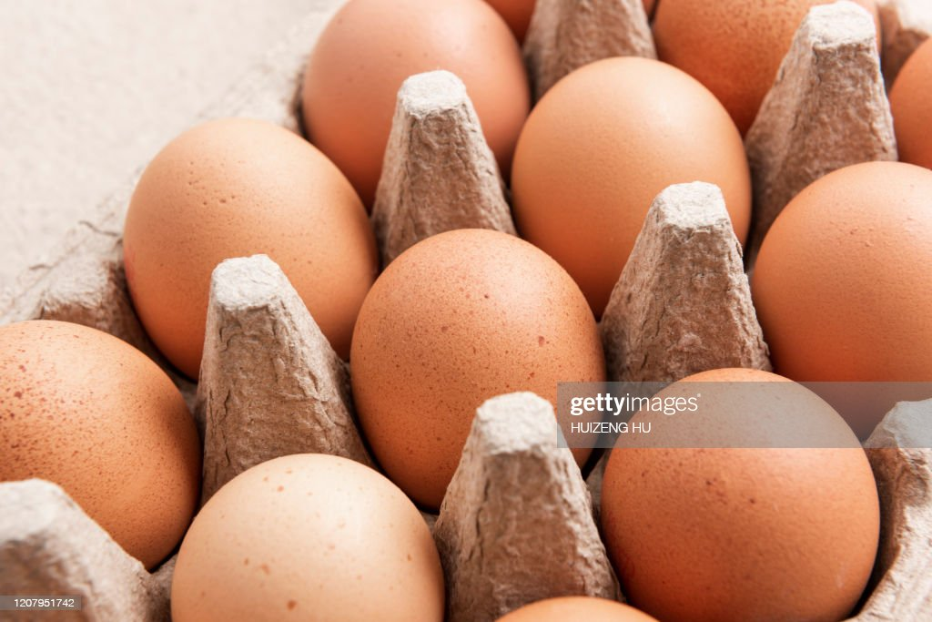 Brown eggs in an egg box, close-up : Stock Photo