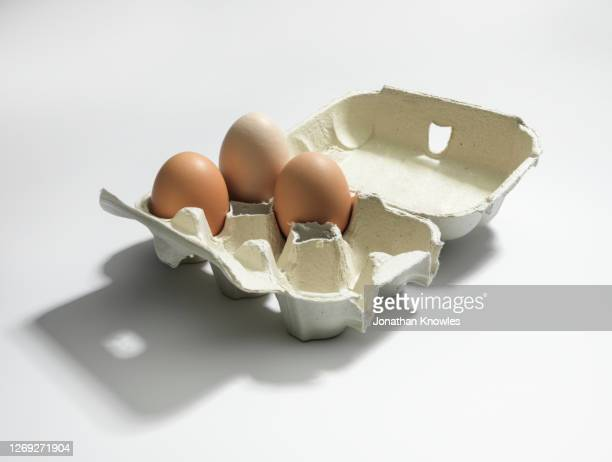 brown eggs in carton - three objects stock pictures, royalty-free photos & images