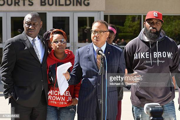 Brown family attorney Benjamin L Crump speaks to the media along with Lesley McSpadden and Michael Brown Sr during a press conference outside the St...