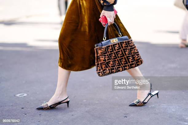 A brown Fendi bag with printed logos Fendi shoes outside Fendi during Paris Fashion Week Haute Couture Fall Winter 2018/2019 on July 4 2018 in Paris...