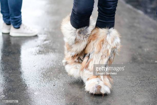 Brown fluffy faux fur boots outside Alexandre Vauthier during Paris Fashion Week Haute Couture Spring Summer 2020 on January 22 2019 in Paris France