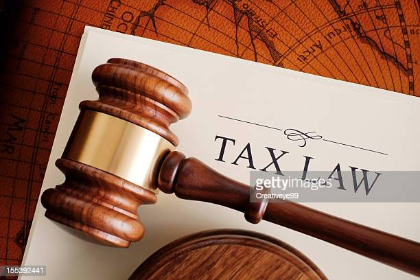 brown gavel on a white tax law document - law stock pictures, royalty-free photos & images