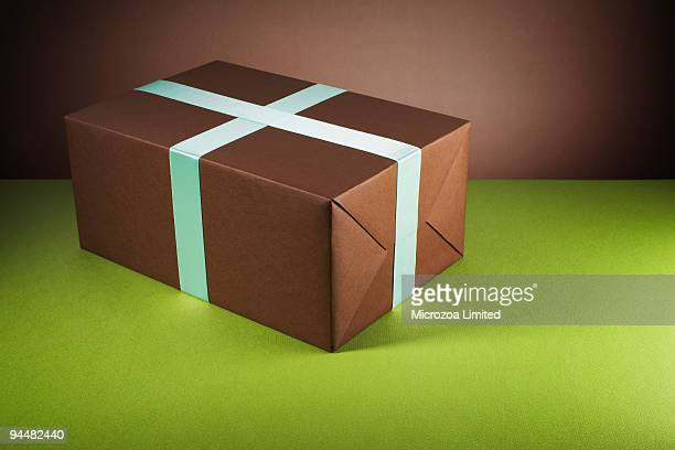 brown gift box - microzoa stock pictures, royalty-free photos & images