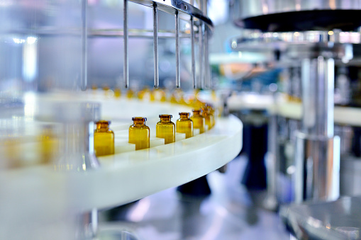 Brown Glass Bottle Filling at Production Line 1157329320