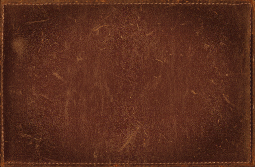 Brown grunge background from distress leather texture with stitched frame 491615480