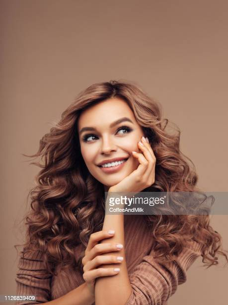 brown haired woman with curly hairstyle - light brown eyes stock photos and pictures
