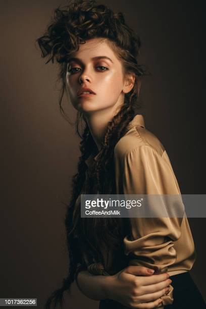 brown haired woman with hairstyle - permed hair stock pictures, royalty-free photos & images