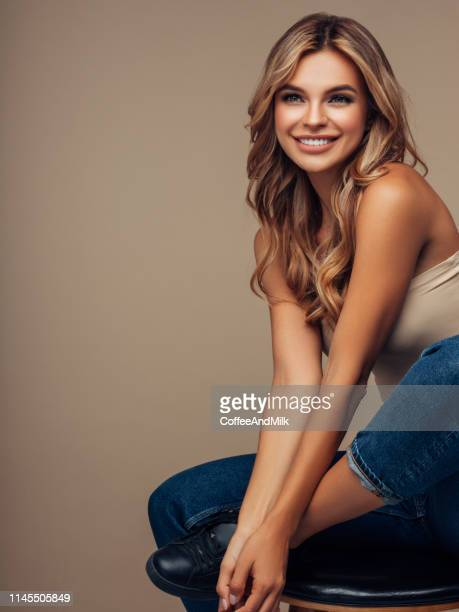 brown haired woman with voluminous hairstyle - permed hair stock pictures, royalty-free photos & images